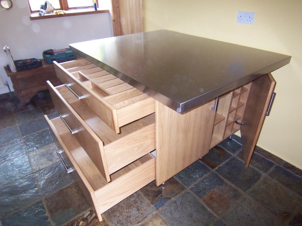 Kitchen island with stainless steel worktop